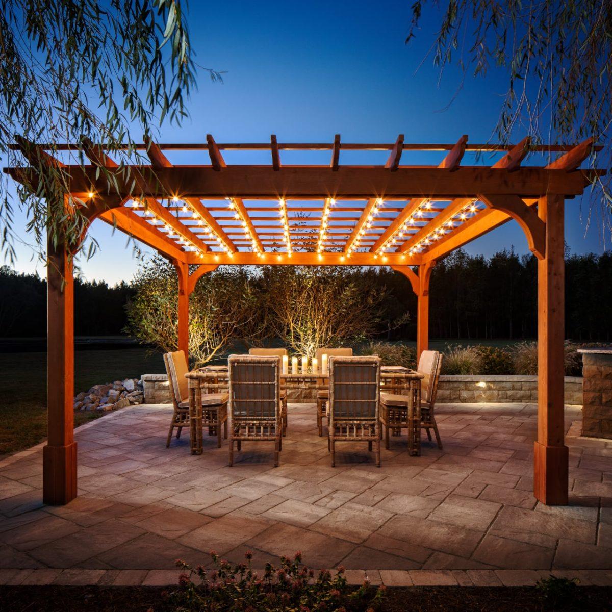 A Belgard outdoor dining room at night